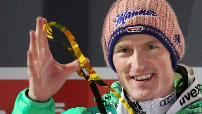 Severin Freund of Germany celebrates after winning the first stage of the Four Hills ski jumping tournament in Oberstdorf, Germany, 29 December 2015. Photo: Fredrik von Erichsen/dpa +++(c) dpa - Bildfunk+++